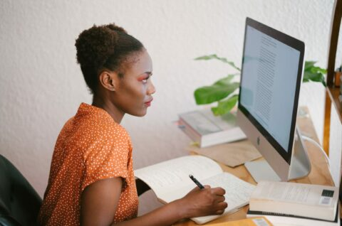 photo-of-woman-looking-on-computer-3059748
